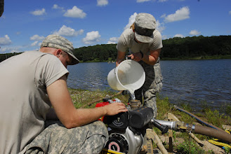 Photo: Wisconsin National Guard Soldiers from the 257 Brigade Support Battalion performed their 2-week annual training at Camp Ripley, Minn. this month. Water Treatment Specialists of Alpha Company spent a few days at Lake Ferrell testing the water, their skills and their equipment. Spc. Adeline Barned primes the water pump with water before starting it.  Photo by Sgt. 1st Class Daniel Ewer http://www.minnesotanationalguard.org/press_room/e-zine/articles/index.php?item=3429