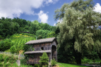 Photo: Covered Bridge Passed by this place everyday to and from our cabin on our recent vacation. It looked like something out of a movie. I particularly liked the house and garden on the hillside. What a view!  (17mm, 1/125, f/8)