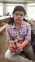 Photo: Retaj shows off her rubber band bracelet creation