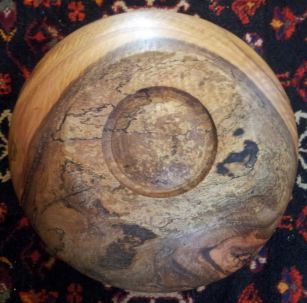 Photo: Bottom of bowl. Burls/burrs are very hard to work with on a lathe, since the wood is prone to chipping and splitting in an unpredictable manner.