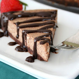 Kahlua Cheesecake with Chocolate Kahlua Sauce