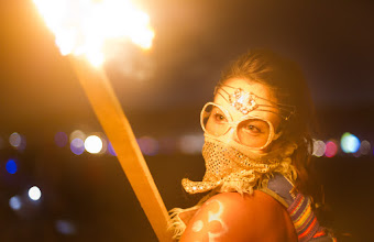 Photo: Girl with a torch at Burning Man...  I'm not sure who this girl is, but she rode by me on a bike holding torch. I was holding my Nikon D3S with a 50mm prime at 1.4, 0.7 EV, 1/125s.
