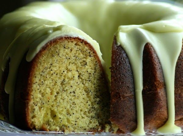 Cake: Preheat oven to 350 degrees. Grease a bundt pan. Beat together cake ingredients with...