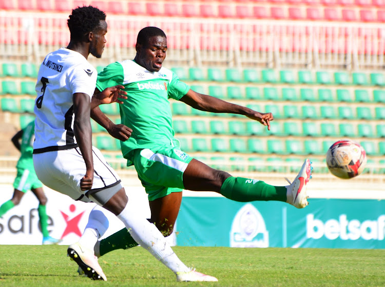 Gor Mahia's Benson Omalla (R) vies for the ball against Mutsinzi Ange APR of Rwanda during their Caf Champions League preliminary round return leg at Nyayo Stadium.