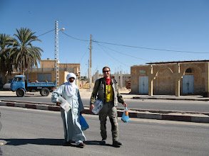 Photo: Pascal returning from an Algerian shop with our guide