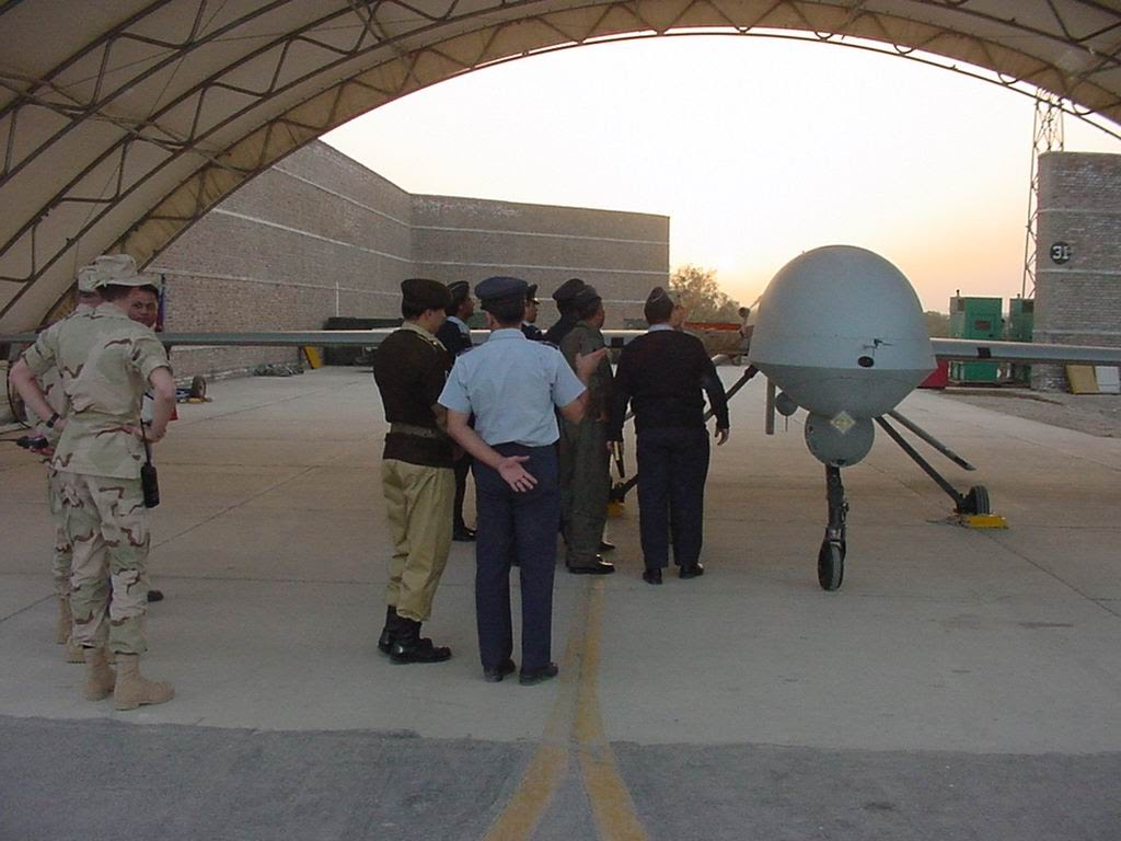 Pakistani and American personnel near a drone