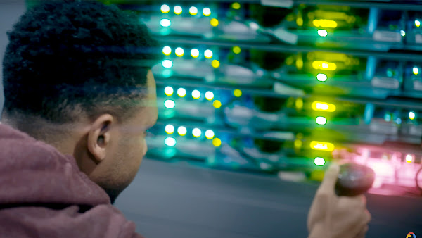 Data Center employee scanning a server stack.