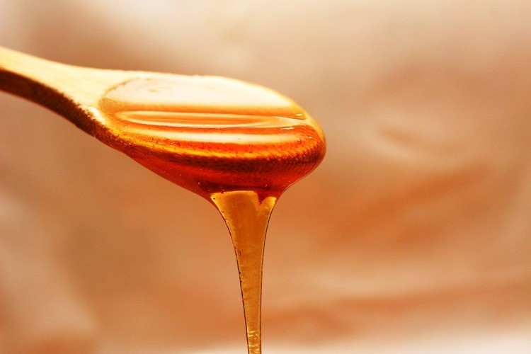 raw honey in spoon