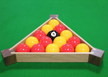 a pool triangle with red and yellow balls