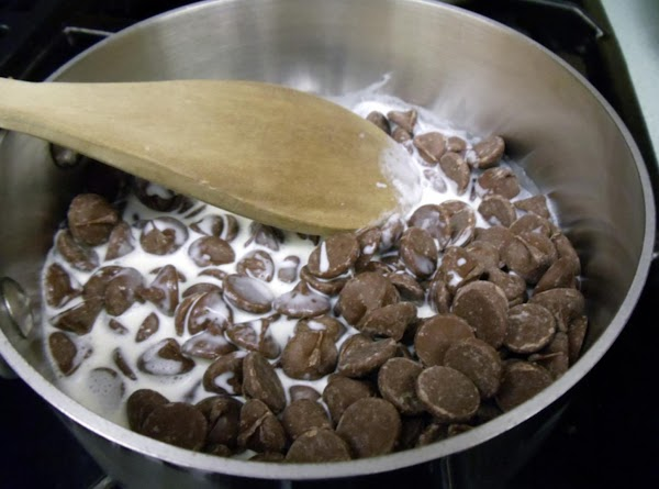 Melt milk chocolate and 1/3 cup cream in medium saucepan over low heat, stirring...
