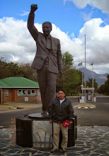 "Photo: Victor and the ""Long Walk to Freedom"" statue at the Drakenstein Correctional Centre, where Nelson Mandela spent the last three years of his incarceration. (http://thebaobabway.com/long-walk-to-freedom-statue/)"