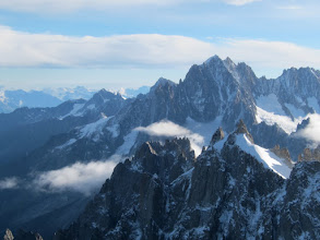 Photo: Swinging our eyes up and to the right we see the incredible jagged teeth of the Mt. Blanc Massif. This is a big mountain, however, and the summit lies almost in back of us. See the next series of photos...