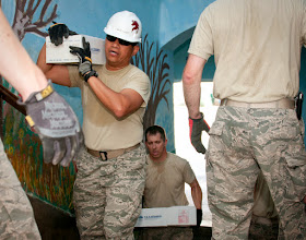 Photo: U.S. Air Force Capt. Fernando Nacionales, 133rd Civil Engineering Squadron, carries construction material into an elementary school in Ogulin, Croatia, June 21, 2014. The school bathrooms are being renovated by Airmen from the 133rd and 148th Civil Engineering Squadron, and 219th RED HORSE Squadron in partnership with the Croatian army. Croatia is a Minnesota state partner under the National Guard State Partnership Program. (U.S. Air National Guard photo by Staff Sgt. Austen Adriaens/Released)