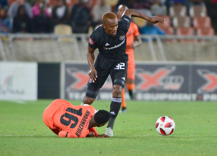 Linda Mntambo of Orlando Pirates gets the better of a challenge from Vusimusi Mngomezulu of Polokwane City during the Absa Premiership match at Peter Mokaba Stadium in Polokwane on Novermber 6, 2018. Pirates won 1-2.