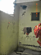 Photo: Back boundary wall was broken to put Jaal. Also you can see hole made for First Floor RHS Bathroom discharge ! - D-41, P-3 GNOIDA, Built by Nanak Builders, Mr. Virender Batra