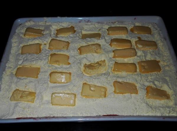 4.Top the  cake with two sticks of butter,  sliced. Like in the picture. Do...
