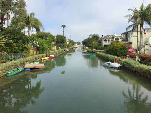 venice-canal.jpg - A view from a footbridge spanning one of the canals of Venice, California.