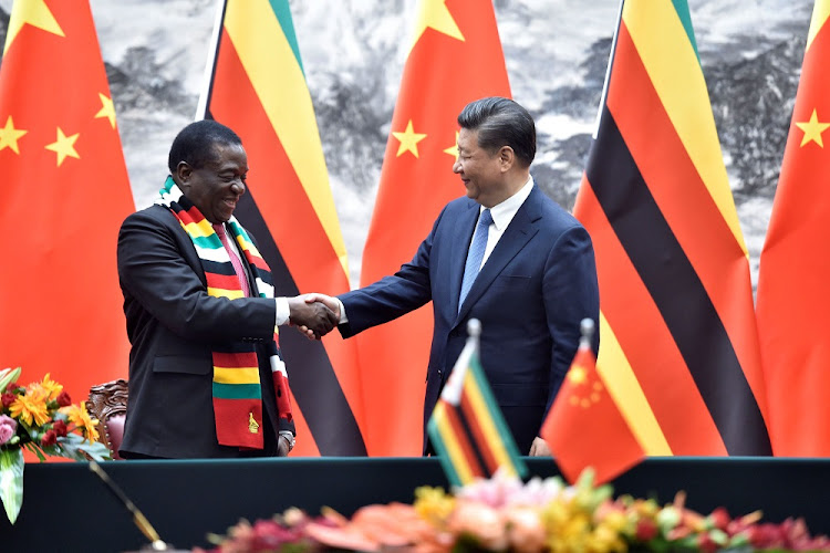 Chinese President Xi Jinping, right, shakes hands with Zimbabwean President Emmerson Mnangagwa after a signing ceremony at the Great Hall of the People in Beijing, China on April 3, 2018.          Picture: PARKER SONG/POOL VIA REUTERS
