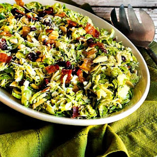 Brussels Sprouts Salad with Bacon, Dried Cranberries, Almonds, and Parmesan