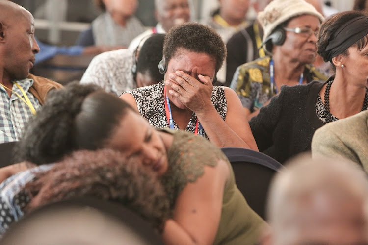Family members become emotional at the Life Esidimeni Arbitrations in Parktown, Johannesburg. Families who testified earlier in the arbitration claimed they found loved ones in the late stages of decomposition while visiting the facility. Picture: ALAISTER RUSSELL/THE TIMES