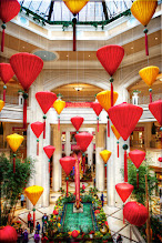 Photo: The Colorful Lanterns  I made it into Las Vegas shortly after the Palazzo unveiled this display for the Year of the Dragon. Although it isn't very prominent in this shot (only the tail is showing), the dragon is enormous. What fascinated me were all of the lanterns hanging from the atrium. The colors and spacing really captured my attention After all, there are plenty of dragons around town (the Bellagio Conservatory has a spectacular display that I'll share in the future), but an atrium full of lanterns is a bit unique.  Now if they ever celebrate something with an atrium full of piñatas, I'm bringing a really long stick to Las Vegas.  Please visit the blog at http://williambeem.com