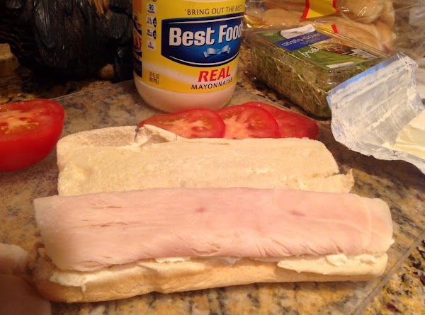 Place two or three slices of Deli Chicken or turkey breast on bun; fold...