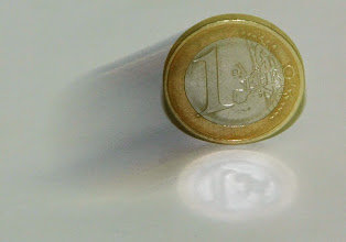 Photo: ** FILE **A euro coin in a long-time exposed picture in Frankfurt, Germany,  Nov. 17, 2004. The euro soared to a new high against the U.S. dollar on Tuesday July 10, 2007 , reaching US$ 1.3696 in afternoon trading in Europe before falling back slightly.  The 13-nation currency was trading at US$1.3694, above the previous high of US$1.3682 it bought on April 27, and above the US$1.3623 it bought in New York late Monday.(AP Photo/Ferdinand Ostrop)
