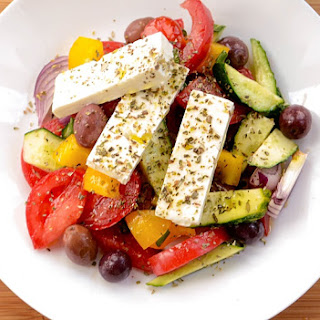 Shepherd Salad With Sweet Pepper, Red Onions And Oregano.