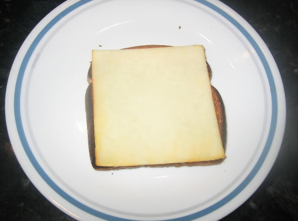 Toast the bread, place cheese slice on top & spoon mixture over, sprinkle with...