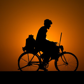 The struggle sets by Awais Mustafa - People Fine Art ( sunset, backlighting, man's struggle )
