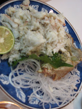 Photo: Raw Crab on a bed of dykon..