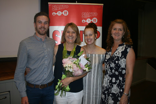 SIAHTO Woman of the Year Kathy Bailey, second from left, with son Todd, daughter Emily and sister Linda Murdoch (who travelled especially from Newcastle for the occasion and had to wait outside so as not to spoil the surprise).