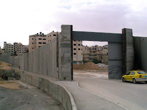 Photo: closeable steel door to Israeli Apartheid Wall in the occupied West Bank, encircling Palestinian villages, cutting Palestinians off from their land, separating families and neighbours, cutting off access to work, school, medical care.  Not about 'security'.