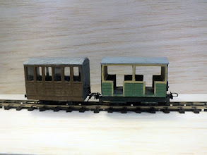 Photo: 008 Bonus item 1: Not featured in the programme, Chris Krupa set up a demo stand to show some of his modelling skills and some items that caught my eye were these superbly finished small 009 coaches. Both of these were built from old Parkside Dundas kits, the one on the left being as the kit intended it to be and the open one being an open coach modified from the same components .