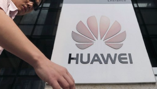 A man walks past a Huawei company logo outside the Huawei office in Wuhan, China. Picture: REUTERS