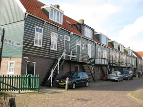 Photo: Houses in Marken. Because of frequent flooding, some houses were built on stilts. You can tell that these were because the front door is on the second floor, and the first floor is brick - it was bricked in to make more living space later on.