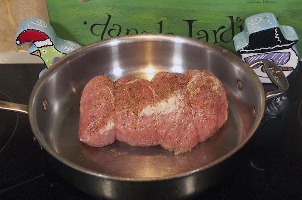 Place the roast in a skillet over medium-high heat.
