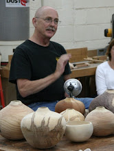 Photo: This man is having fun. One look at John in action makes it clear that he loves his work, and loves teaching it. In the foreground are vessels in progress.