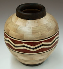 "Photo: Stan Sherman -segmented vessel - 8"" x 8"" - maple, ebony, bloodwood, holly"
