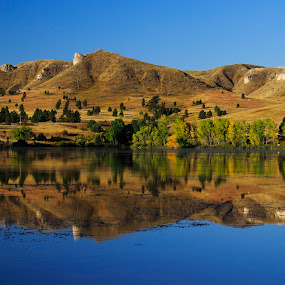 Hillside Reflection by Eric Wellman - Landscapes Waterscapes ( hills, reflection, fall, lake )