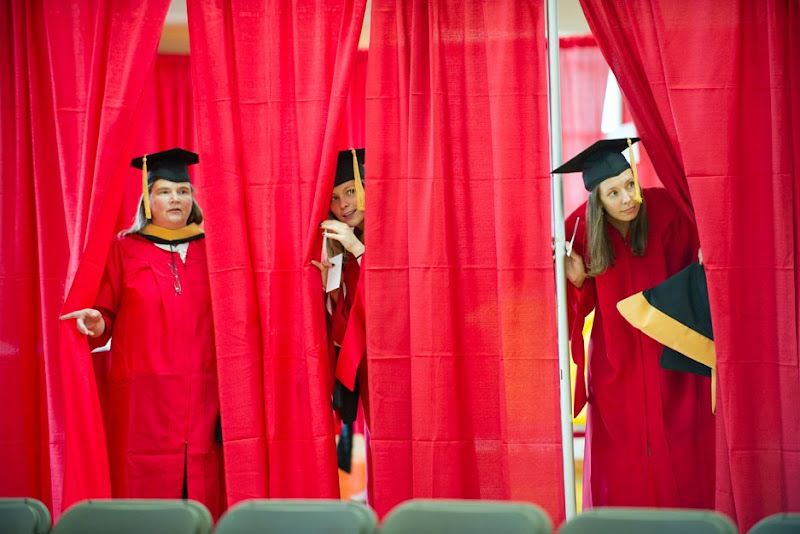 Photo: Scoping out the scene: Master's degree candidates Ann Olson (SSW'12) (from left), Angelica Morse (SSW'12), and Kylee Thomson (SSW'12) seem anxious for their School of Social Work convocation, held Friday at FitRec, to start. Photo by Cydney Scott