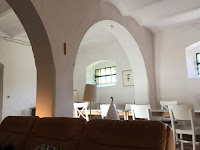 Elegant pointed arches create a warm and quiet atmosphere