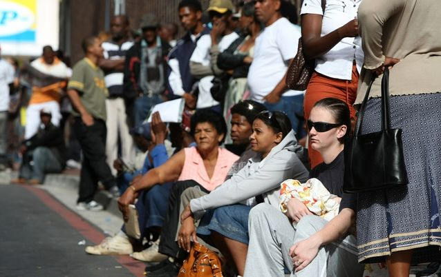 Payment delays: Unemployed people queue for Unemployment Insurance Fund benefits payments. Some beneficiaries that applied in April have still not been paid. Picture: SUNDAY TIMES