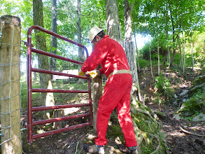 Photo: Doug closing rthe new gate behind the church to get into the cow field where the cave is