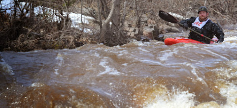 Photo: An unidenfitied kayaker on the Naked Man Rapid during the Lester River Race on Saturday, April 27.