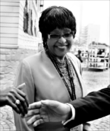 HONOURABLE MEMBER: ANC NEC member Winnie Madikizela-Mandela arrives for the swearing in ceremony of members of Parliament in Cape Town yesterday. 06/05/09. Pic. Schalk van Zuyman. © AP.