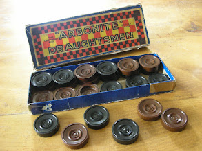 Photo: CH310 English plastic set of 'Arbonite' draughtsmen (US=Checkers). Probably mid/late-1930's.    As there is no mention of the Royal Warrant on the above box, it would seem likely that this set pre-dates its 1938 grant.   By 1951 CV is said to have boasted c.1,000 different items in its product list!