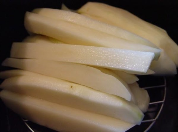 Cut your potatoes to steak size fries. rinse and drain.