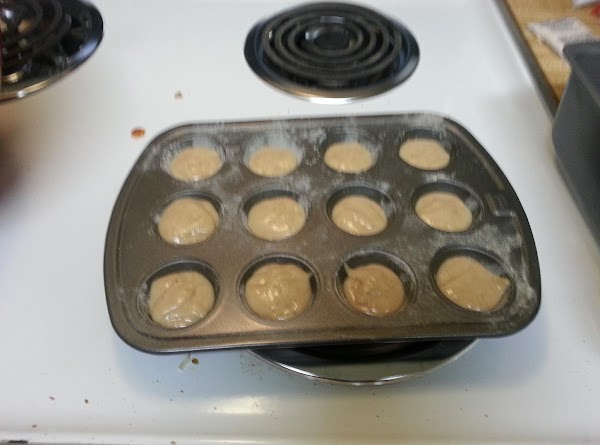 Divide batter evenly among cups in greased muffin pan.(I grease with a light coat...