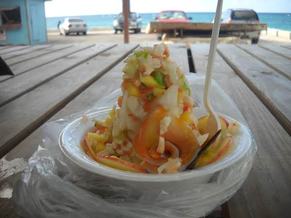 Conch Salad Piled High With Herbs And Apple Slices. You Can Eat This Hot Or Mild To Your Taste. Apples Are Optional Its Good With Raisins, Pear Or Mango ;-)
